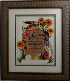 A beautiful invitation with quilled flowers.
