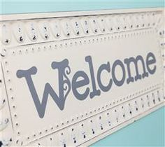 Create this friendly sign to welcome friends and family into your home.
