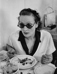Marlene Dietrich eating lunch.