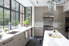 pristine white kitchen. i love black window frames.