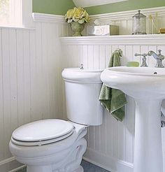 Beadboard wainscoting and period fixtures define this classic half-bath. | Photo: Andrew Bordwin |