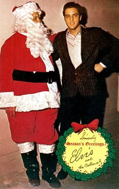 Elvis Presley poses with Colonel Tom Parker (dressed as Santa Claus) in this Christmas card circa 1965.
