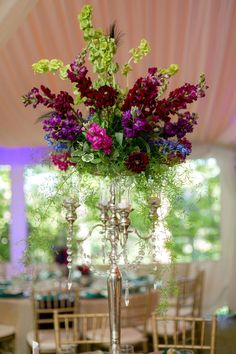 Gorgeous tall centerpieces | Baroque Peacock Inspired Wedding In Jewel Tones of Purple, Green & Turquoise | Photograph by Eric Asistin Photography http://www.storyboardwedding.com/baroque-style-enchanted-outdoor-garden-peacock-inspired-wedding/