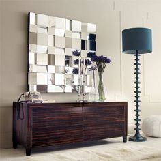 A beautiful large multi facet wall mirror is a stylish way of adding more light into a room.