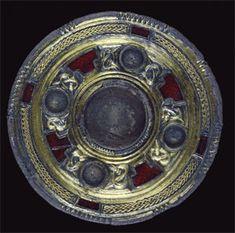 Silver-gilt jewelled disc brooch from Faversham, Kent (5.1cm diameter) (AN1909.196).