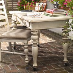 The perfect finishing touch for your home office or den, this turned wood writing desk pairs 2 essential drawers with a chic linen finish. ...