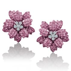 Fast forward to the year 2000, Le Vian's love affair with flowers continues. 18K white gold flower earrings featuring 280 invisbly set pink sapphires (28 total carats!) centered with diamonds.