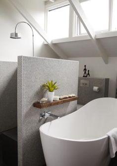 bathtub against shower wall