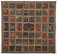 Cotton batik wall hanging with 54 squares dyed in natural colours blue, green, red and black depicting scenes from wayang kulit plays, ceremonies and daily life with European influences, the mirror with two initials: O.v.N.i.P. and L.v.G.v.O. and dated 19 november 1873, the squares seperated by images of dragons, 220 x 210 cm