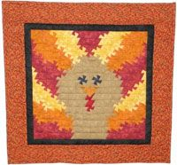 """Turkey Twist Pattern by Handcrafts by Jennifer at KayeWood.com. This pattern includes instructions for three sizes. The small size uses the Itty Bitty Primitive Pinwheel Tool and is a 24 1/2"""" square. The medium size uses the Primitive Pinwheel Tool and is a 39"""" square. The large size uses the Lil' Twister Ruler and is a 62 1/2"""" square. http://www.kayewood.com/item/Turkey_Twister_Pattern/3158 $9.00"""