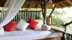 Veranda Natural Resort - Cambodia #glamping | A collection of private bungalows made from stone, wood and thatch, tucked within the lush jungles of Cambodia below Kep National Park.