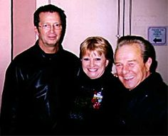 Charlie and wife Joan with Eric Clapton,  Los Angeles, 2000.