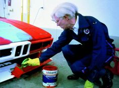 Andy Warhol painting a BMW as part of the BMW Art Car Collection