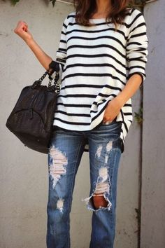 Black and white lined shirt and ripped jeans