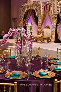 Suhaag Garden, Indian Wedding Decorators, Florida Wedding Decorators, Reception Centerpieces, Drooping , Champagne Wedding, Gold Wedding, Peacock Feathers, Peacock Symbol, Sapphire, Plum Linens, Teal Napkins, Peacock Inspired
