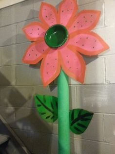 Flower made from cardboard a pool noodle and a paper bowl.