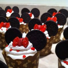 Mickey Mouse Cupcakes.  Make your favorite cupcakes and ice them with buttercream.  Use oreo cookies for ears and sprinkle red dots on top of icing.  For the bow, cut a piece of chocolat or candy into triangles, brush with a bit of icing and dip in red sugar.  Pipe red icing for center.  (This can also be made with fondant)