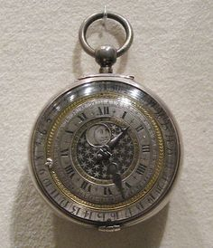 1650 English Calendar watch at the Metropolitan Museum of Art, New York - This clock has dials showing the time, date, and also what appears to either be the phases of the moon or the passage of day/night.