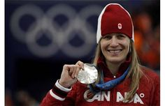 Silver medallist Canada's Kristina Groves poses with her medal after the women's 1500 metres at the Richmond Olympic Oval during the Vancouver 2010 Winter Olympics February 21, 2010.
