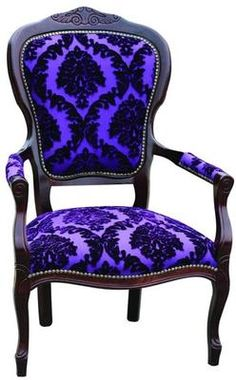 This would be a favorite chair in my home.  Although the style is traditional the striking color of the fabric is awesome.