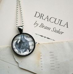 "Spooky bling!  Vampire bat pendant necklace made with ""Dracula"" excerpts (in gift tin) for Halloween fun; by CrowBiz"
