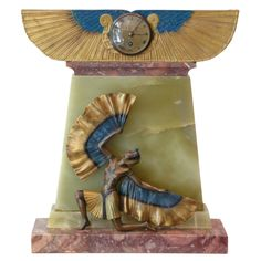 An Exquisite Art Deco Mantel Clock | From a unique collection of antique and modern sculptures at http://www.1stdibs.com/furniture/more-furniture-collectibles/sculptures/