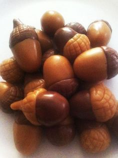 Get a bag of caramels and a bag of little tootsie rolls. Pop them in the microwave for 8 seconds (just enough to soften but not melt) then roll them up and shape into acorns....