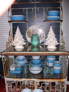 Snowflake Blue Pyrex display with pretty ceramic trees.
