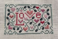 Stitchin' and Life in a Small Town: More Stitchy Finishes - design All You Need Is Love, a freebie from the Drawn Thread uses Kreinik Silk Mori.
