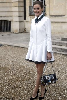 Fashion Front Row @ #PFW Fall 2014   Olivia Palermo in a Christian Dior outfit featuring a white shirt dress & black pumps styled with a turquoise necklace & a floral print clutch