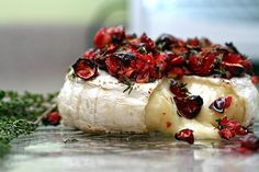 Baked brie with maple syrup, cranberries, thyme, and orange zest! Make sure you use a round of brie, all sides encased in rind. If not, the cheese will melt everywhere in the oven!! Worked great with blackberries.