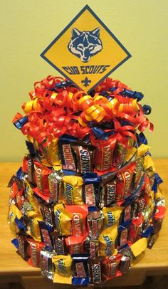 @Brittany Horton Horton Peterson  Annual cake auction????   during the Blue & Gold banquet this weekend. As a family we are to create a cake for the auction. It's a fund raising event for their pack. Since I'm not much of a baker (though I can made some killer brownies!) we made a candy bar cake!