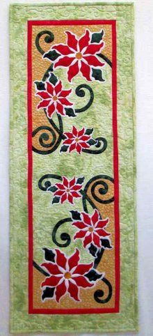"""Poinsettia Wallhanging Pattern by Jeri Kelly at KayeWood.com. Beautiful Christmas themed wallhanging. Or, use as a tablerunner! Dimensions 15"""" x 40"""". http://www.kayewood.com/item/Poinsettia_Wallhanging_Pattern/3376 $8.50"""