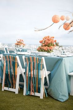 ribbon on chair backs . . . neat way to dress up rentals.