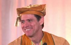 """Official Commencement Address Graduating Class of 2014 from Maharishi University of Management, May 24th, 2014 by Jim Carrey Faculty, Parents, Friends, Dignitaries... Graduating Class of 2014, and all the dead baseball players coming out of the corn to be with us today. (laughter) After the harvest there's no place to hide — the fields are empty — there is no cover there! (laughter)  I am here to plant a seed that will inspire you to move forward in life with enthusiastic hearts and a clear sense of wholeness. The question is, will that seed have a chance to take root, or will I be sued by Monsanto and forced to use their seed, which may not be totally """"Ayurvedic."""" (laughter)  Excuse me if I seem a little low energy tonight — today — whatever this is. I slept with my head to the North last night. (laughter) Oh man! Oh man! You know how that is, right kids? Woke up right in the middle of Pitta and couldn't get back to sleep till Vata rolled around, but I didn't freak out. I used that time to eat a large meal and connect with someone special on Tinder. (laughter)  Life doesn't happen to you, it happens for you. How do I know this? I don't, but I'm making sound, and that's the important thing. That's what I'm here to do. Sometimes, I think that's one of the only things that are important. Just letting each other know we're here, reminding each other that we are part of a larger self. I used to think Jim Carrey is all that I was...  Just a flickering light  A dancing shadow  The great nothing masquerading as something you can name  Dwelling in forts and castles made of witches–wishes! Sorry, a Freudian slipthere  Seeking shelter in caves and foxholes, dug out hastily  An archer searching for his target in the mirror  Wounded only by my own arrows  Begging to be enslaved  Pleading for my chains  Blinded by longing and tripping over paradise–can I get an """"Amen""""?! (applause)  You didn't think I could be serious did ya'? I don't think you understand who you're dealing with!"""