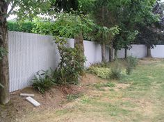 Chain link fence with white slats.