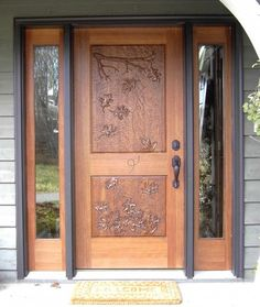 I really like the look of hand carved doors.  It would be cool to have one for the front entrance if it I could fit it into the budget.  I expect it will cost too much though...
