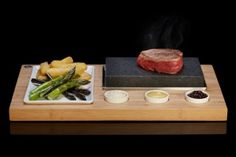 The SteakStones Sizzling Steak Set ($100): Simply heat these lava stones up they'll let you sear up a perfect steak wherever you lay them.
