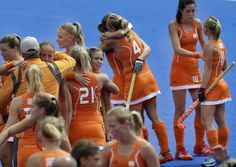 The Netherlands Field Hockey team congratulates each other shortly after defeating Belgium 3-0 in the women's hockey preliminary match at the 2012 Summer Olympics, Sunday, July 29, 2012, in London.