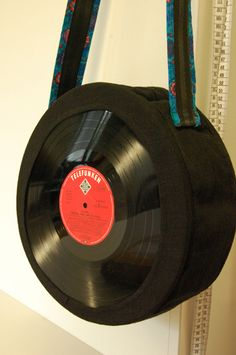 This looks great and a fun way to repurpose some old records that don't play well any more. - DIY record & fabric purse