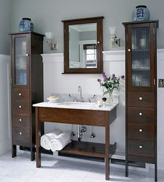 Tall slim storage cabinet to replace open wire shelving in bathroom.
