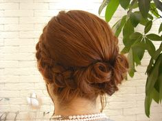 Loose side (lace?) braid into low messy bun