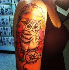 Owl On Compass
