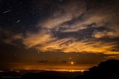 """Perseid meteor shower 2012. (Photo: Thomas O'Brien) Taken from Mt Evans, Colorado overlooking Denver. The meteors are debris from comet Swift-Tuttle. ©Mona Evans, """"Meteor Shower - the Perseids"""" http://www.bellaonline.com/articles/art27461."""