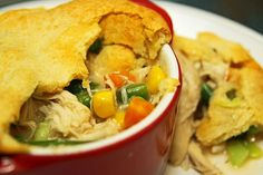 My family loves this easy recipe, using cream of chicken soup, frozen veggies, chicken and crescent rolls.  We even add cheese!