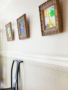 Kids' artwork gallery. Use traditional frames. Cute.
