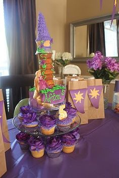 Rapunzel party - easier cake. Love the gift bags.    LOVE these ideas, and looks cute but doesnt cost a arm and a leg!!