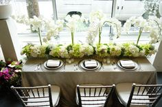 Modern table design by Nancy Liu Chin of white and green flowers