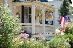 """Iconic American front porch - check out the arched """"stained glass"""" window used for privacy! From Front-Porch-Ideas-and-More.com #porch"""