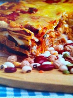 Chicken Enchilada Cake    Serves 4    8 Tortillas (20cm/8inch)  1 Jar (450g/15oz) Enchilada Sauce  2 Cups Shredded Cooked Chicken  150g Mozzarella Cheese, Shredded    Preheat the oven to 200C/400F. Line a 20cm (8inch) round cake tin with baking paper. Make layers in this order: Tortilla, Enchilada Sauce, Chicken, and Mozzarella. Continue the layer process until all the ingredients are used. Bake until the cheese is completely melted and the sauce bubbling, about 30 minutes.